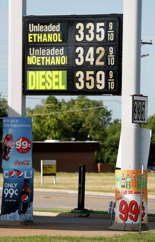 This photo taken June 20, 2013 shows a sign advertising pricing for different types of gasoline is pictured at a gas station in Oklahoma City. A high blend of ethanol gasoline, E15, which contains 5 percent more ethanol than the 10 percent norm sold at most U.S. gas stations, is sold in just 20 stations in six Midwestern states. But sales could spread as the Obama administration considers whether to require more ethanol in gasoline; it's cheaper and cleaner but it could damage older cars and motorcycles. And American Petroleum Institute, the oil industry's powerful lobbying group, has asked the Supreme Court to block it's sale. The Court may decide as soon as Monday, June 24, 2013, whether to hear the case.  (AP Photo/Sue Ogrocki) Photo: Sue Ogrocki