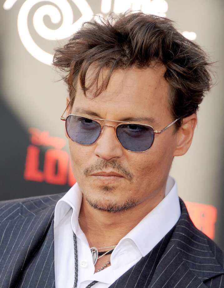 "ANAHEIM, CA - JUNE 22:  Actor Johnny Depp arrives at ""The Lone Ranger"" World Premiere at Disney's California Adventure on June 22, 2013 in Anaheim, California.  (Photo by Gregg DeGuire/WireImage)"