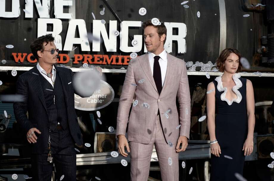 "ANAHEIM, CA - JUNE 22:  (L-R) Actors Johnny Depp, Armie Hammer, and Ruth Wilson arrive at the premiere of Walt Disney Pictures' ""The Lone Ranger"" at Disney California Adventure Park on June 22, 2013 in Anaheim, California.  (Photo by Kevin Winter/Getty Images)"