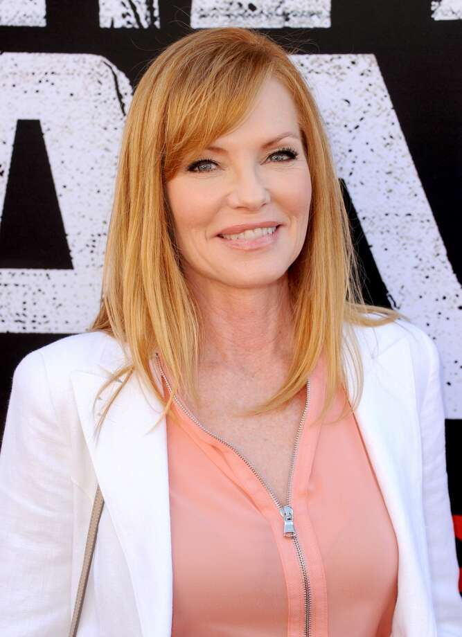 "ANAHEIM, CA - JUNE 22:  Actress Marg Helgenberger arrives at the premiere of Walt Disney Pictures' ""The Lone Ranger"" at Disney California Adventure Park on June 22, 2013 in Anaheim, California.  (Photo by Kevin Winter/Getty Images)"