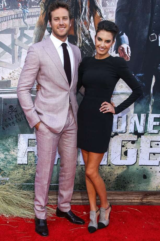 "ANAHEIM, CA - JUNE 22:  Actor Armie Hammer (L) and Elizabeth Chambers attend the premiere Of Walt Disney Pictures' ""The Lone Ranger"" at Disney California Adventure Park on June 22, 2013 in Anaheim, California.  (Photo by Paul A. Hebert/Getty Images)"