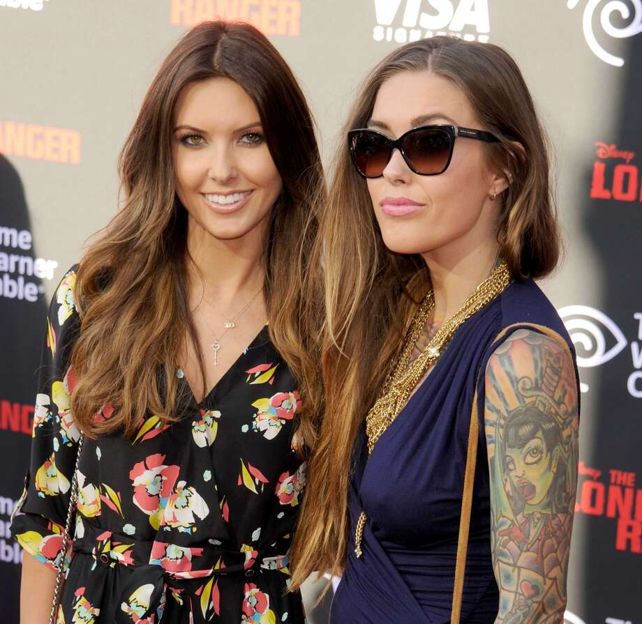 "ANAHEIM, CA - JUNE 22: TV personality Audrina Patridge and sister Casey Patridge arrive at ""The Lone Ranger"" World Premiere at Disney's California Adventure on June 22, 2013 in Anaheim, California.  (Photo by Gregg DeGuire/WireImage)"