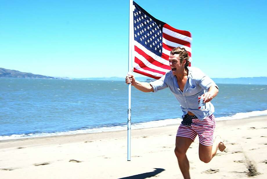 "Chubbies co-founder Preston Rutherford celebrates the company's 'Mericas shorts at Baker Beach. Among the garment's distinctions is the word ""boomshakalaka"" under the zipper. Photo: Chubbies"