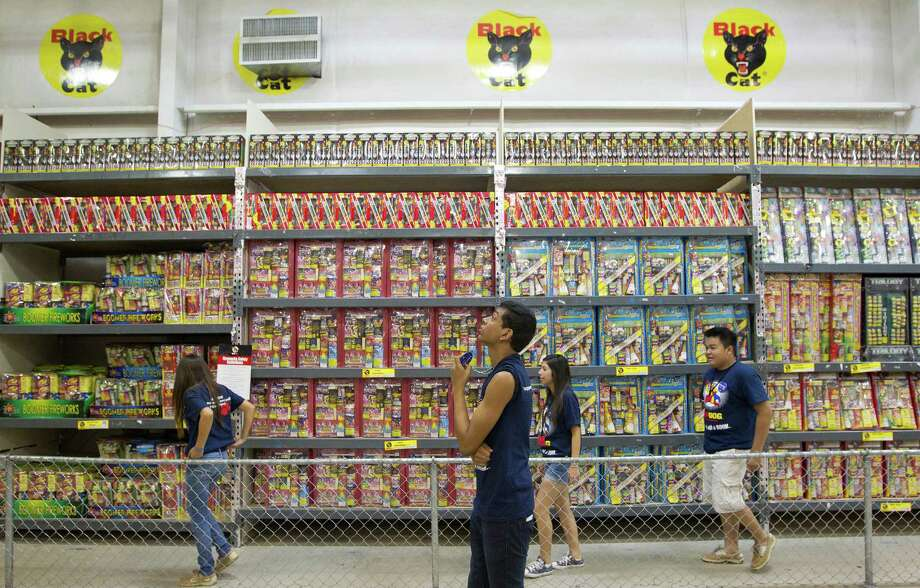 A group of student volunteers from Cypress Springs High School work at Top Dog Fireworks, during the first day of firework sales Monday, in Houston.  Many student and parent volunteers from Cypress Springs High School work at Top Dog Fireworks as proceeds from the sales go to support the Cypress Springs band and Key Club among other organizations. Photo: Johnny Hanson, Houston Chronicle / © 2013  Houston Chronicle