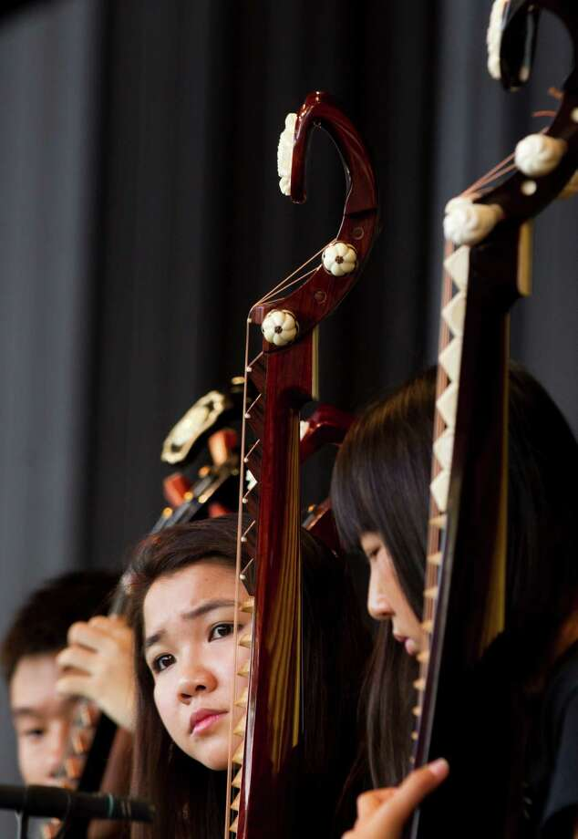 Amanda Cheung, plays a pipa with the Chinese Ensemble during the Houston Young Artists' Concert at Miller Outdoor Theatre in Houston. A second performance scheduled for July 2. Photo: Brett Coomer, Houston Chronicle / © 2013 Houston Chronicle