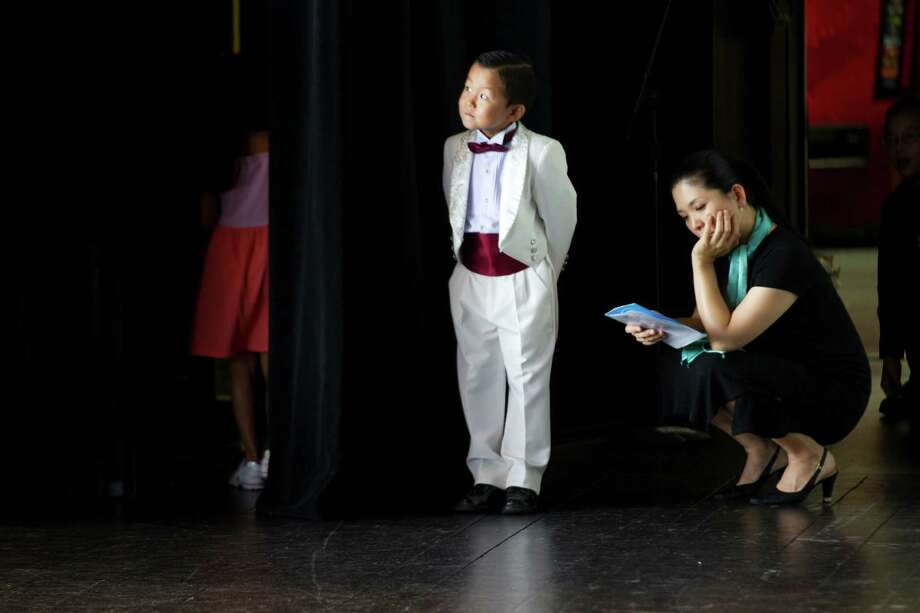 Pianist Henry Li, 6, waits backstage to perform during the Houston Young Artists' Concert at Miller Outdoor Theatre in Houston. Several young classical musicians ages 4 to 18 performed with the hope of fostering a greater appreciation for classical music in the Houston area.  Photo: Brett Coomer, Houston Chronicle / © 2013 Houston Chronicle