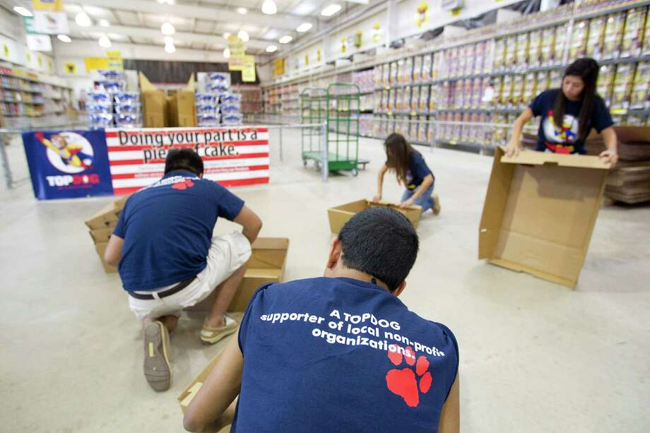 A group of student volunteers from Cypress Springs High School assemble firework shooting boxes while working at Top Dog Fireworks, during the first day of firework sales Monday, in Houston. 