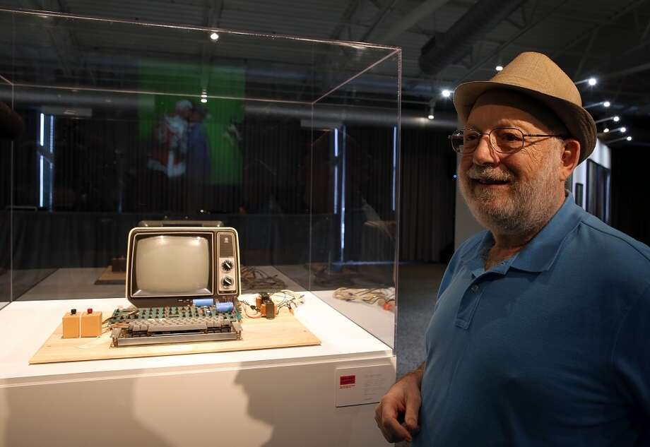 Ted Perry stands next to his Apple-1 computer during the First Bytes: Iconic Technology From the Twentieth Century, an online auction featuring vintage tech products at the Computer History Museum on June 24, 2013 in Mountain View, California.  Christie's is auctioning off an original Apple-1 computer owned by Ted Perry as part of its First Bytes: Iconic Technology from the Twentieth Century, an online auction of vintage tech products. The online auction begins today and runs through July 9.