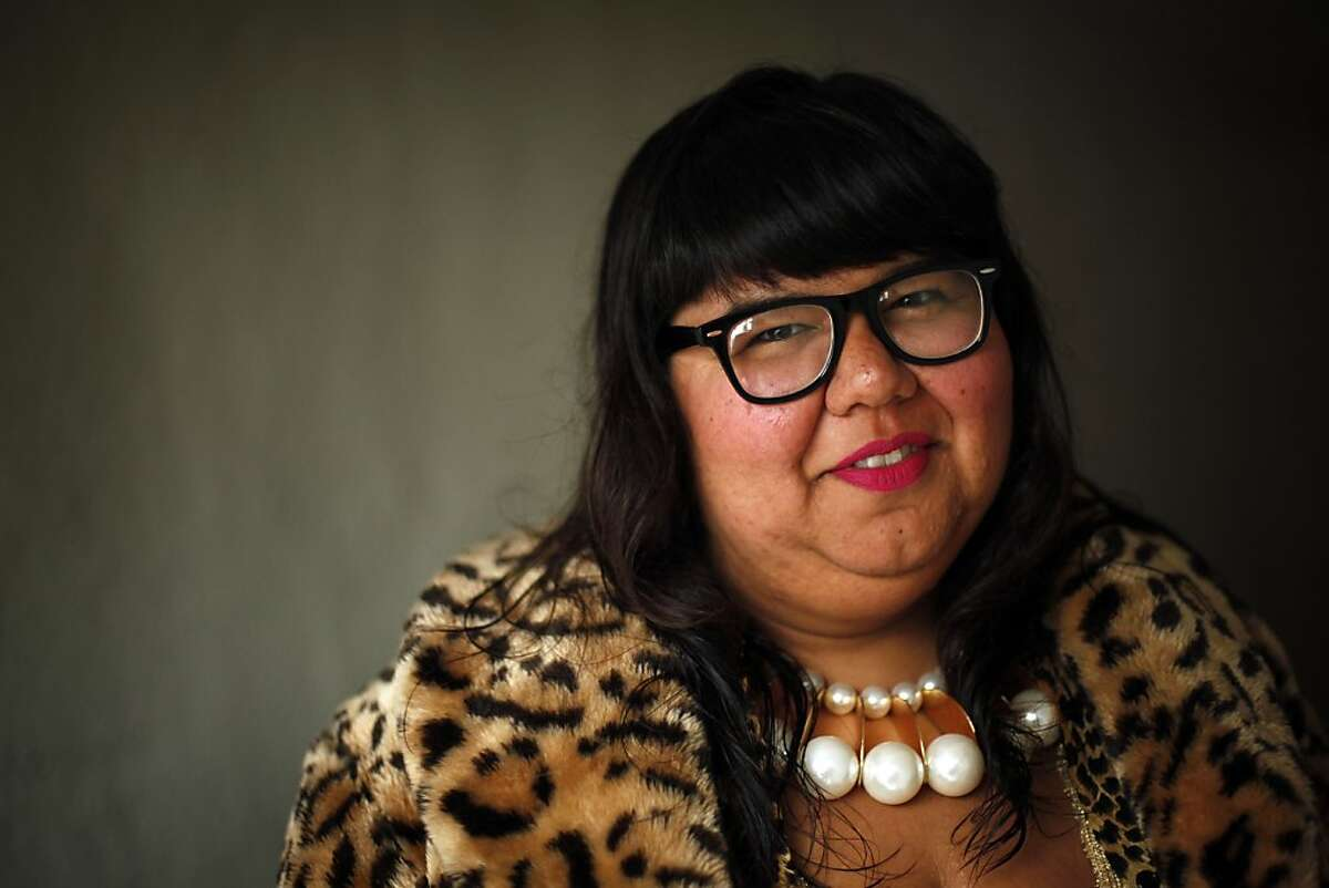 """Virgie Tovar of San Francisco, Calif., shown here in her apartment on Sunday, June 23, 2013, is one of the critics of the American Medical Association's announcement that it is officially considering obesity a """"disease"""" -- Tovar is a well-known fat acceptance activist. The Fat Acceptance community has pushed back particularly strongly."""