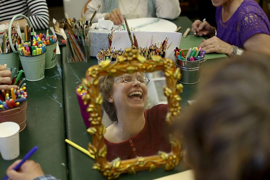 Marie Vick laughs at a fellow group member's joke during a meeting of UCSF's Art for Recovery. In Art for Recovery's Firefly Project, students exchange letters with cancer patients. Photo: Ian C. Bates, The Chronicle