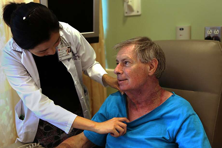 Dr. Bernice Kwong of Stanford Cancer Center's Supportive Dermato-Oncology Clinic checks patient Michael Grubb. Photo: Liz Hafalia, The Chronicle