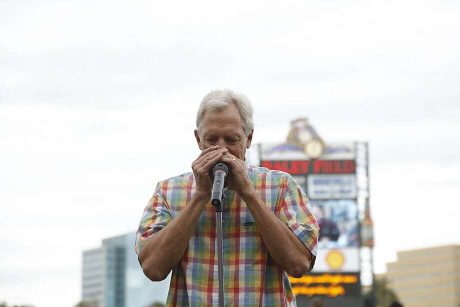 Chronicle columnist Scott Ostler plays the national anthem at Sunday's River Cats game. Photo: Dianne Rose, Sacramento River Cats