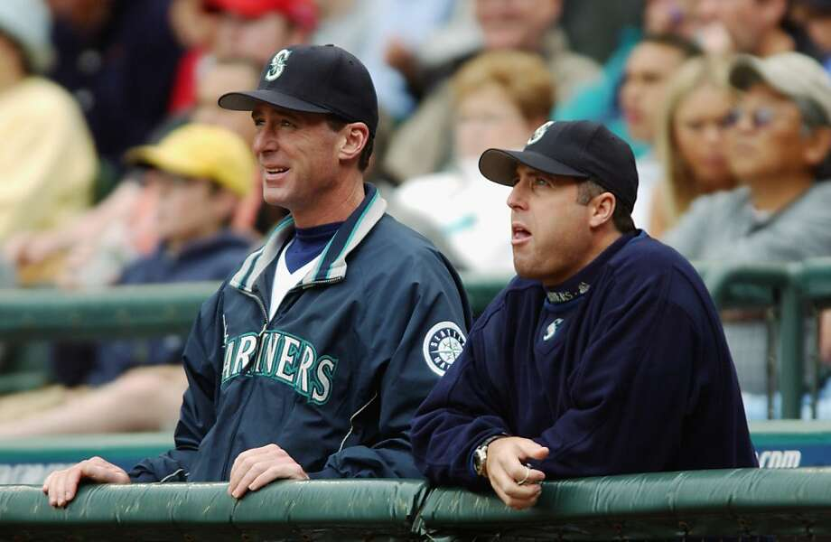 Manager Bob Melvin (left) and pitching coach Bryan Price - baseball lifers - did not work together until 2003 with the Seattle Mariners. Photo: Otto Greule Jr, Getty Images