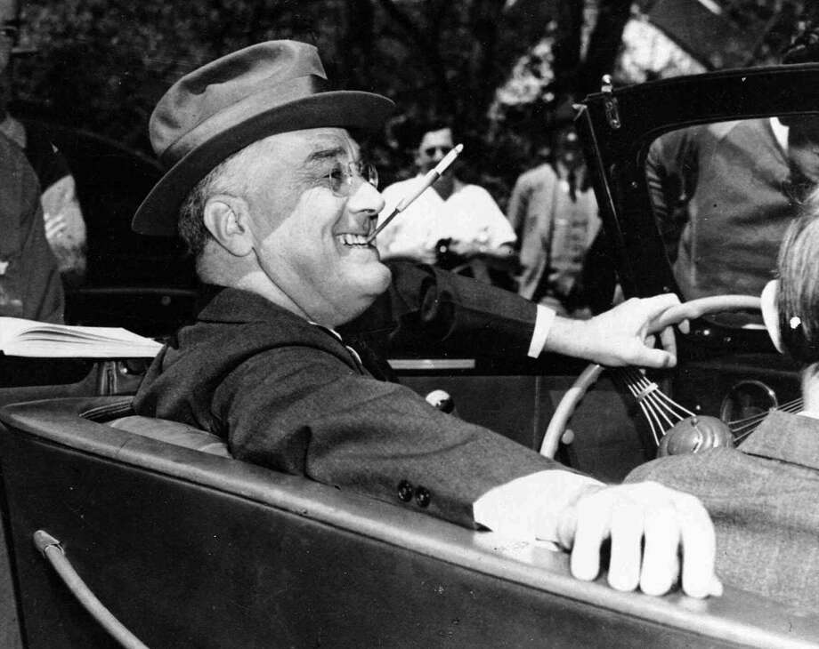 ADV. FOR SUN., NOV. 7--FILE--President Franklin Delano Roosevelt sits at the steering wheel of his automobile at Warm Springs, Ga.,  April 4, 1939.  Most of the country didn't know then that more than a decade before taking the presidential oath, Roosevelt had been stricken with crippling polio.(AP Photo/File) / AP