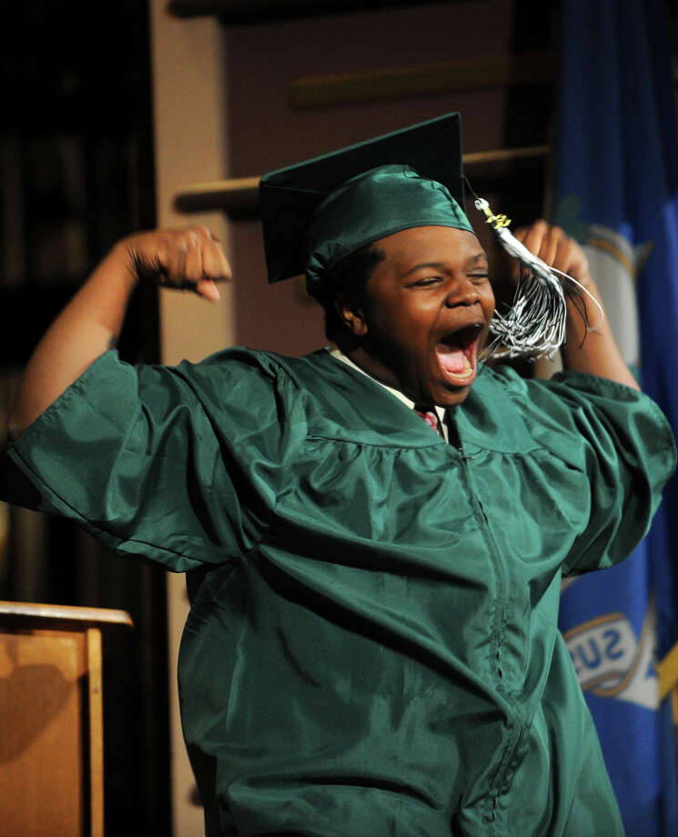 Graduate Tyrell Conley celebrates as he heads up for his diploma at the Bassick High School graduation at the Klein Memorial Auditorium in Bridgeport, Conn. on Monday, June 24, 2013. Photo: Brian A. Pounds / Connecticut Post