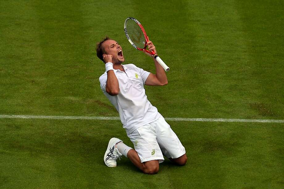 Belgium's Steve Darcis celebrates one of the most stunning upsets in Wimbledon history. Photo: Carl Court, AFP/Getty Images