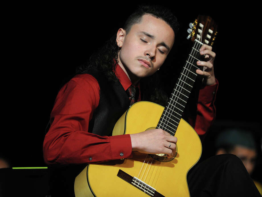 Bassick Talent Show winner Victor Ramirez performs on the guitar at Bassick High School graduation at the Klein Memorial Auditorium in Bridgeport, Conn. on Monday, June 24, 2013. Photo: Brian A. Pounds / Connecticut Post