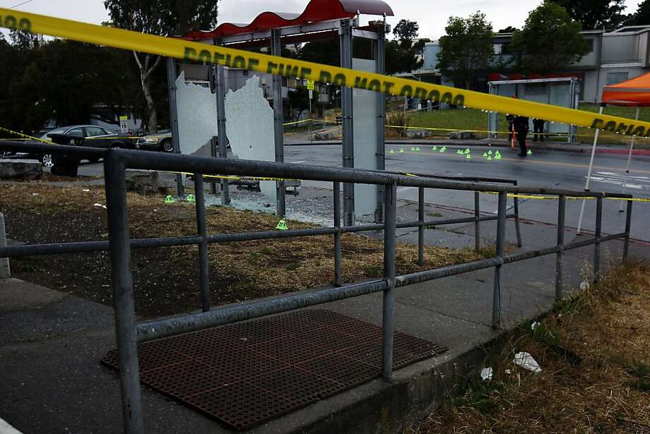 A bus shelter was shattered by bullets at the scene of a double shooting on Monday in San Francisco. Photo: Rohan Smith, The Chronicle