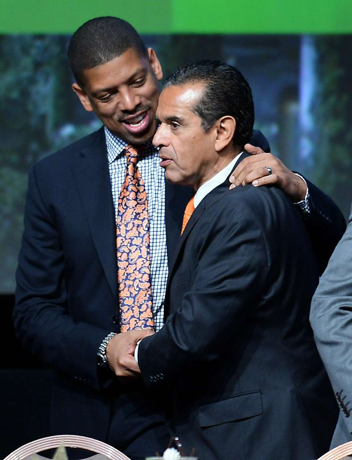 LAS VEGAS, NV - JUNE 21: Sacramento Mayor Kevin Johnson (L) talks with Los Angeles Mayor Antonio Villaraigosa at the 81st annual U.S. Conference of Mayors at the Mandalay Bay Convention Center on June 21, 2013 in Las Vegas, Nevada. U.S. Vice President Joe Biden spoke at the conference addressing about 150 mayors from across the country on issues including the economy, immigration reform and gun violence. (Photo by Ethan Miller/Getty Images)