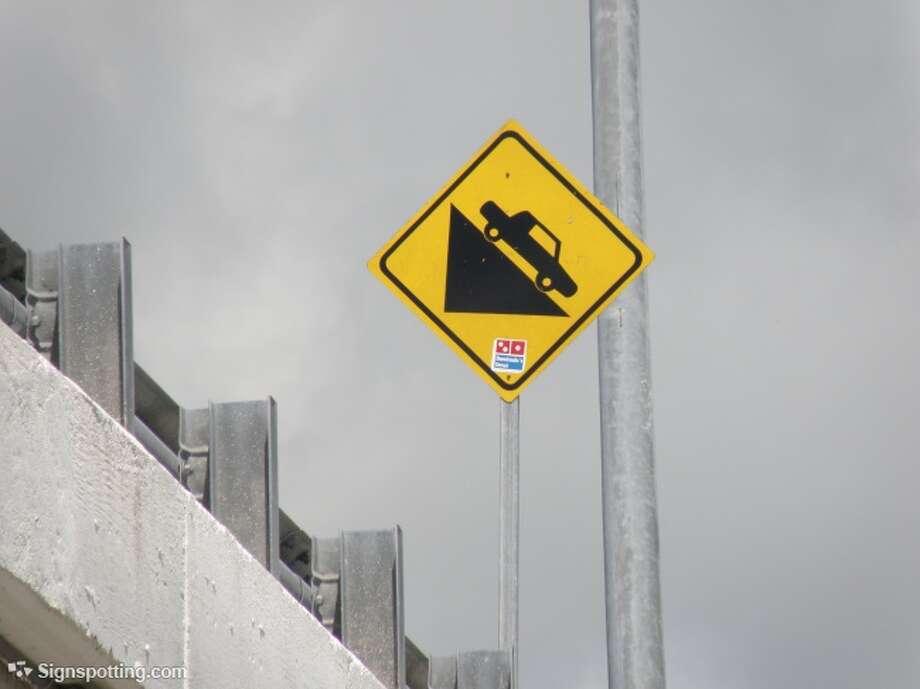 Danger: falling cars! Akumal, Mexico.