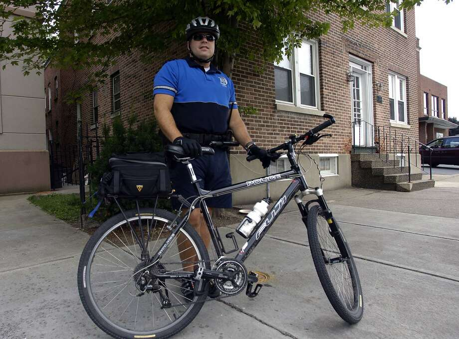 Times Union Photo by James Goolsby-July 25,2007- Officer Kevin Green, A Schenectady Police officer for 14 years. Patrols the streets of Schenectady on a bike. Photo: JAMES GOOLSBY / ALBANY TIMES UNION