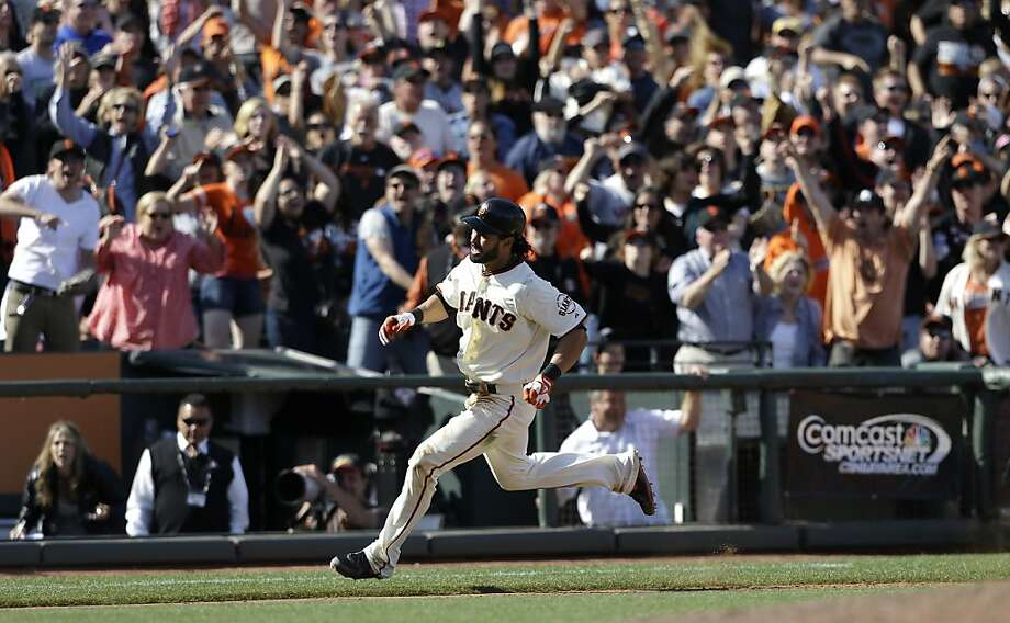 Angel Pagan rounds third base to score on his inside-the-park homer to beat the Rockies in the 10th inning May 25. The home run occurred after Pagan injured his hamstring in that game. Photo: Jeff Chiu, Associated Press
