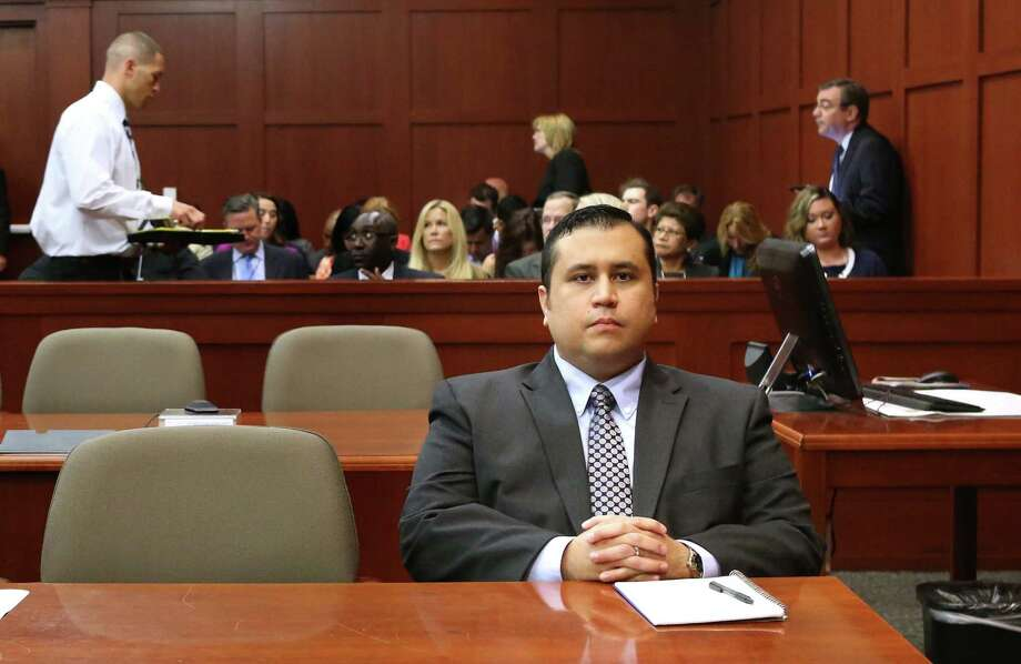 George Zimmerman waits for his defense counsel to arrive in Seminole circuit court for his trial, in Sanford, Fla., Monday, June 24, 2013. Zimmerman has been charged with second-degree murder for the 2012 shooting death of Trayvon Martin. (AP Photo/Orlando Sentinel, Joe Burbank/Pool) Photo: Joe Burbank