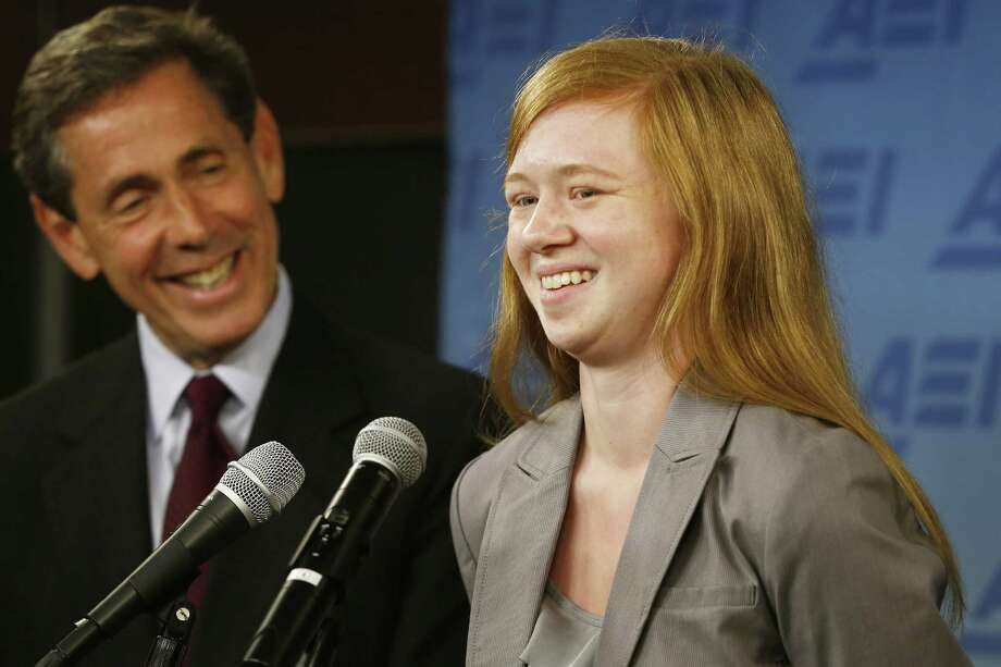 Abigail Fisher, the Sugar Land woman who has been the  face of debate on affirmative action since 2008, speaks Monday at a news conference with activist   Edward Blum. Story on page A4. Photo: Charles Dharapak, STF / AP