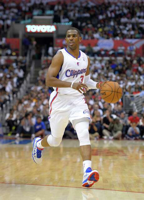 Chris Paul is likely to remain a Clipper with Doc Rivers coming aboard as coach. Photo: Mark J. Terrill, STF / AP