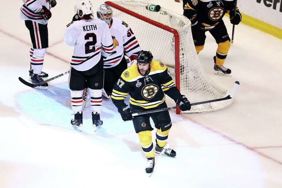 BOSTON, MA - JUNE 24:  Milan Lucic #17 of the Boston Bruins celebrates after scoring a goal in the third period against Corey Crawford #50 of the Chicago Blackhawks in Game Six of the 2013 NHL Stanley Cup Final at TD Garden on June 24, 2013 in Boston, Massachusetts. Photo: Elsa, Getty Images / 2013 Getty Images