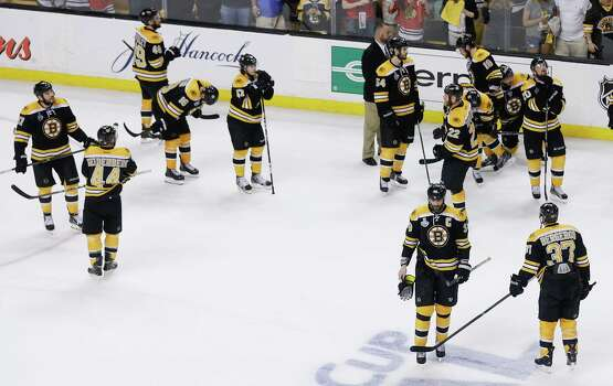 The Boston Bruins stand on ice after being defeated by the Chicago Blackhawks 3-2 in Game 6 of the NHL hockey Stanley Cup Finals, Monday, June 24, 2013, in Boston. (AP Photo/Charles Krupa) Photo: Charles Krupa, Associated Press / AP