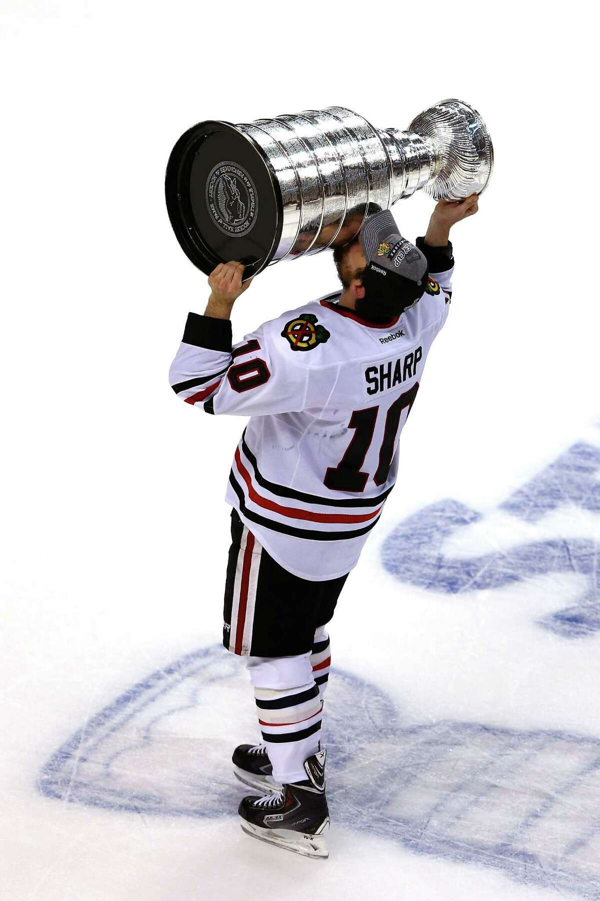 Game 6: Chicago 3, Boston 2 BOSTON, MA - JUNE 24: Patrick Sharp #10 of the Chicago Blackhawks kisses the Stanley Cup as he celebrates after they won 3-2 against the Boston Bruins in Game Six of the 2013 NHL Stanley Cup Final at TD Garden on June 24, 2013 in Boston, Massachusetts.