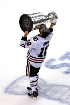 Game 6: Chicago 3, Boston 2BOSTON, MA - JUNE 24:  Patrick Sharp #10 of the Chicago Blackhawks kisses the Stanley Cup as he celebrates after they won 3-2 against the Boston Bruins in Game Six of the 2013 NHL Stanley Cup Final at TD Garden on June 24, 2013 in Boston, Massachusetts. Photo: Elsa, Getty Images / 2013 Getty Images