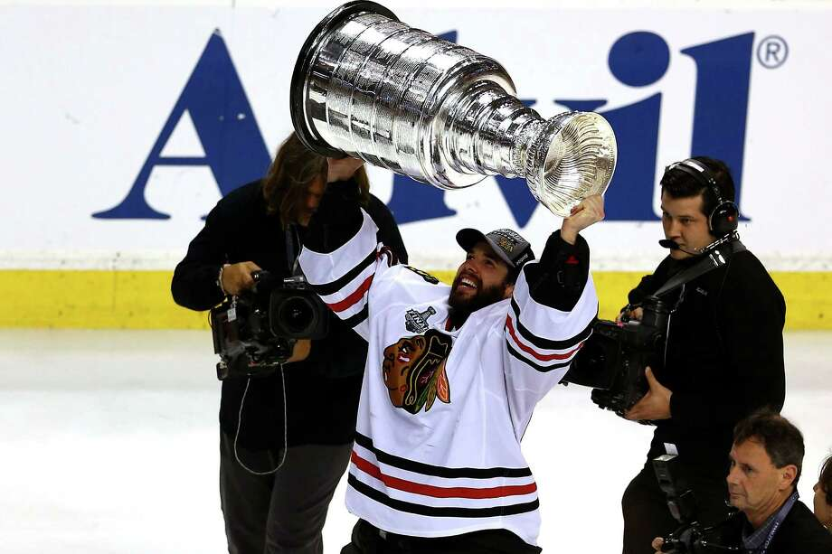 BOSTON, MA - JUNE 24:  Goalie Corey Crawford #50 of the Chicago Blackhawks celebrates with the Stanley Cup after they won 3-2 against the Boston Bruins in Game Six of the 2013 NHL Stanley Cup Final at TD Garden on June 24, 2013 in Boston, Massachusetts. Photo: Elsa, Getty Images / 2013 Getty Images