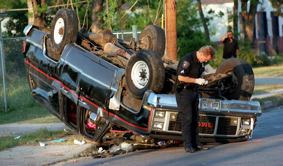 Lee Rakun gathers information at an accident many years ago. After the third time facing termination, the police lieutenant will return to work. (San Antonio Express-News file photo)