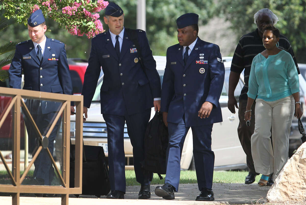 Senior Airman Christopher Oliver (second from left) pleaded guilty Monday to having liaisons with three recruits.