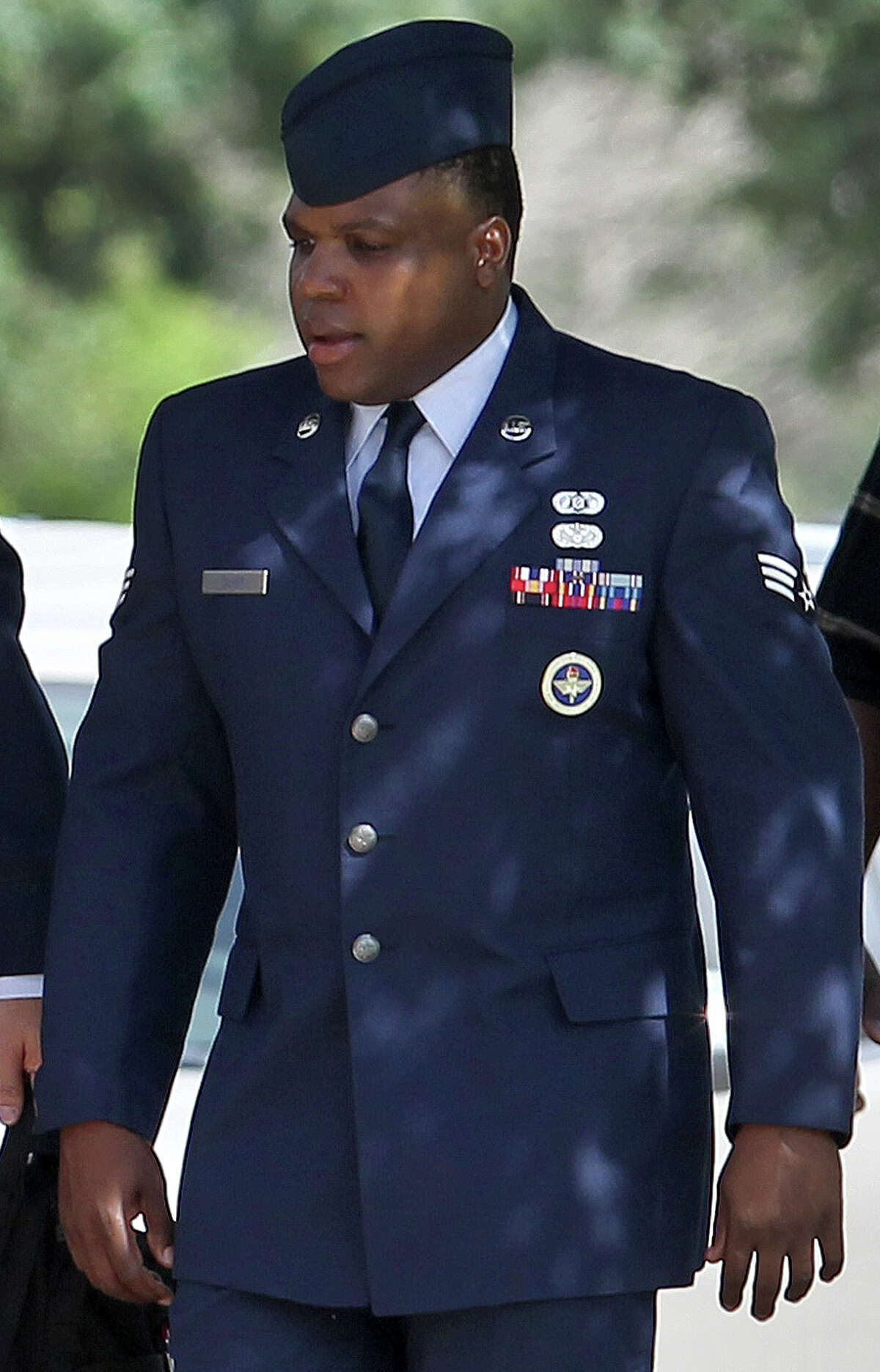 Senior Airman Christopher Oliver walks Monday June 24, 2013 at Joint Base San Antonio-Lackland. Oliver is facing a court-martial on charges of aggravated sexual assault and abusive sexual conduct of one basic training recruit and other charges.