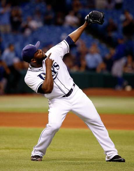 The Rays' Fernando Rodney puts an exclamation point on his save after closing out Toronto 4-1 and ending the Blue Jays' 11-game winning streak Monday. Photo: J. Meric, Stringer / 2013 Getty Images