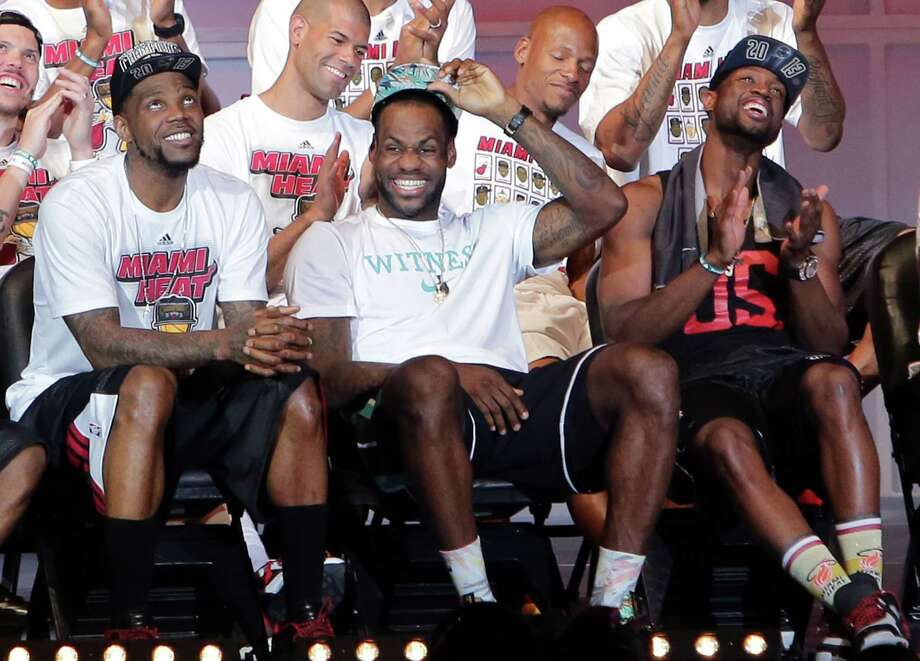 LeBron James (center) and the Heat treated Miami to its second consecutive championship parade. An estimated 400,000 people braved the warm weather to attend the celebration of the NBA Finals win over the San Antonio Spurs. Photo: Alexander Tamargo, Stringer / 2013 Getty Images