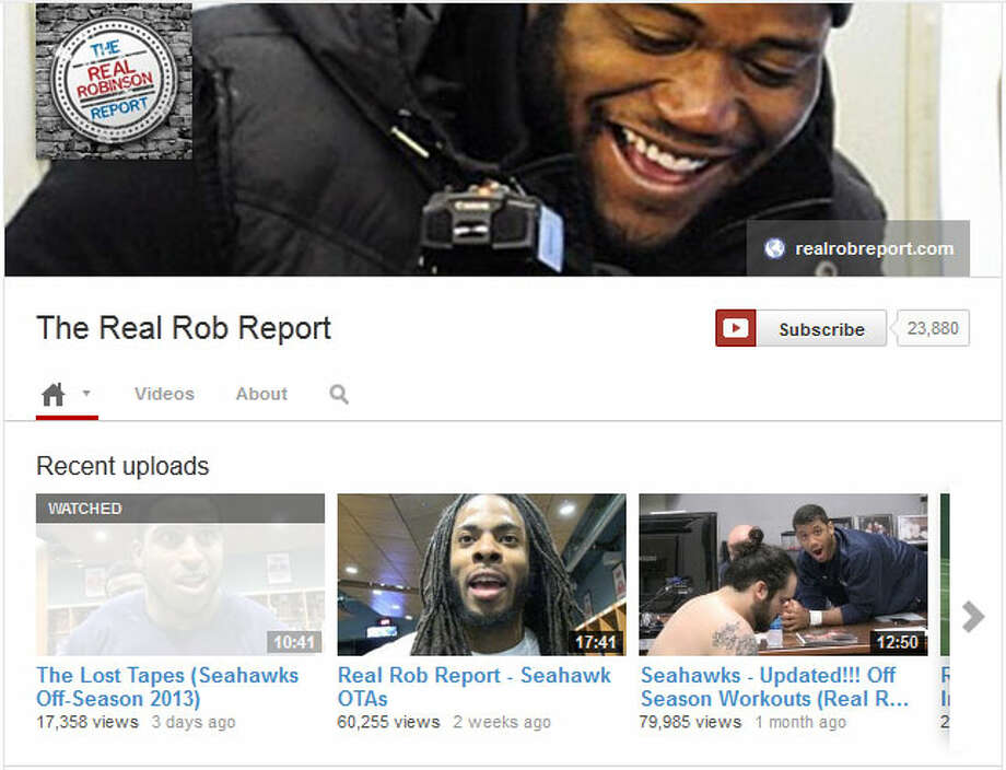 Catch up on the 'Real Rob Report'  If you've never watched any ''Real Rob Report,'' you're in for a treat. Seahawks fullback Michael Robinson posts videos on YouTube from inside the Seahawks locker room -- though less often right now than his weekly videos during the season. But it's one of the best things out there for Seahawks fans -- you can get to know your favorite personalities in a very unique way.