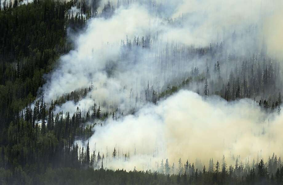 A wildfire burns on a hillside along highway 149 west of Creede, Colo., Monday, June 24, 2013. Crews defending small homes, a ski area and a handful of roads against an erratic wildfire in Colorado's southwest mountains hoped Monday for a break — any break — in the weather that will allow them to launch a more strategic assault on the backcountry blaze. (AP Photo/Gregory Bull) Photo: Gregory Bull, Associated Press