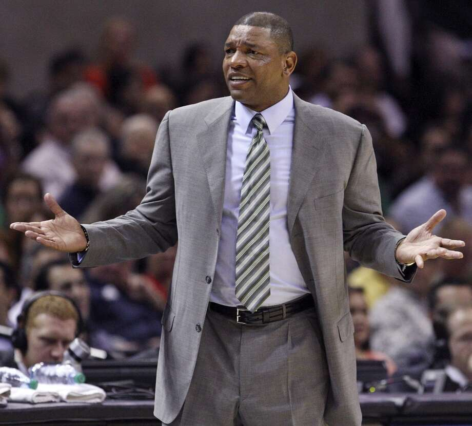 Before he was coach of the Los Angeles Clippers, Doc Rivers was ...  PHOTO: Rivers reacts after a play during the Celtics' first half action against the Spurs on Dec. 15, 2012, at the AT&T Center. Photo: Edward A. Ornelas, San Antonio Express-News