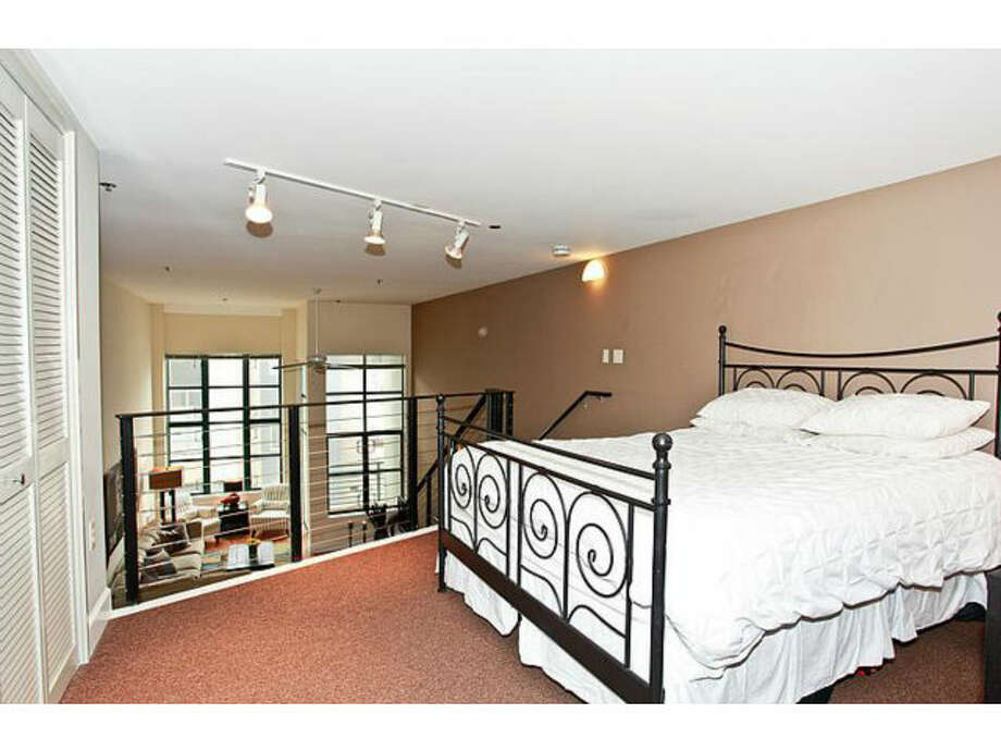 Bed on upper level. Photos via Redfin/Rica Ruiz, KW Peninsula Estates/MLS