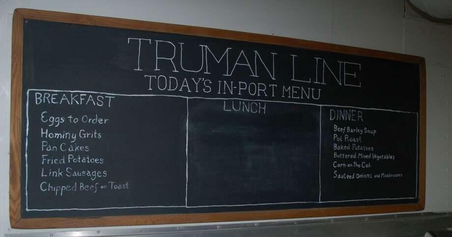 Sailors' typical breakfast and  dinner menu are still visible on the the Truman Line chalkboard.