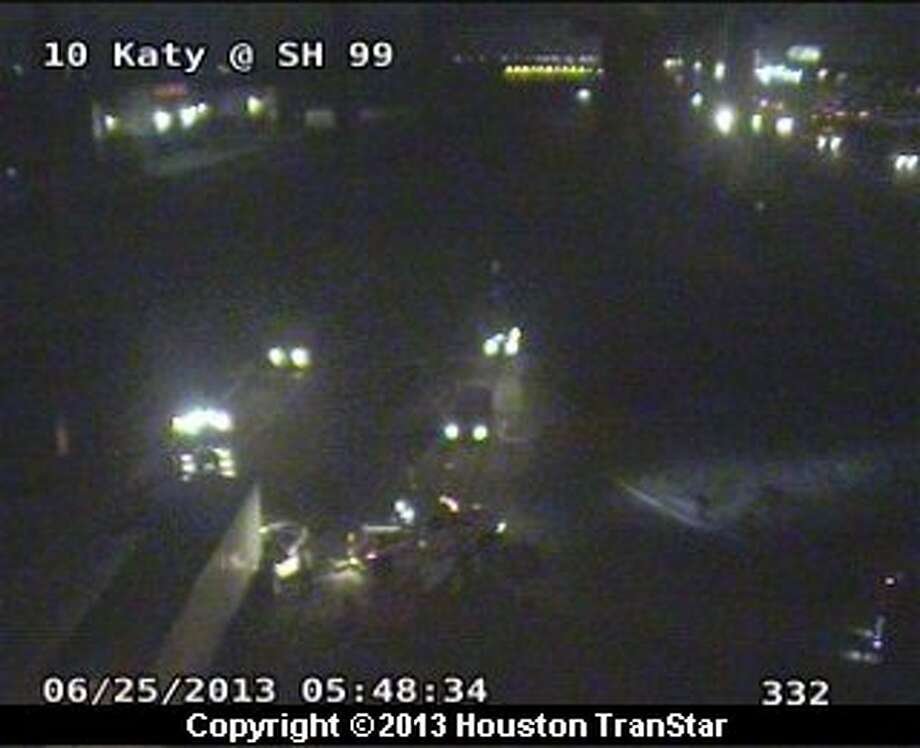 Portions of the westbound Katy Freeway frontage road were blocked after big-rig crash early Tuesday that left one person dead. Photo: Houston Trantsar