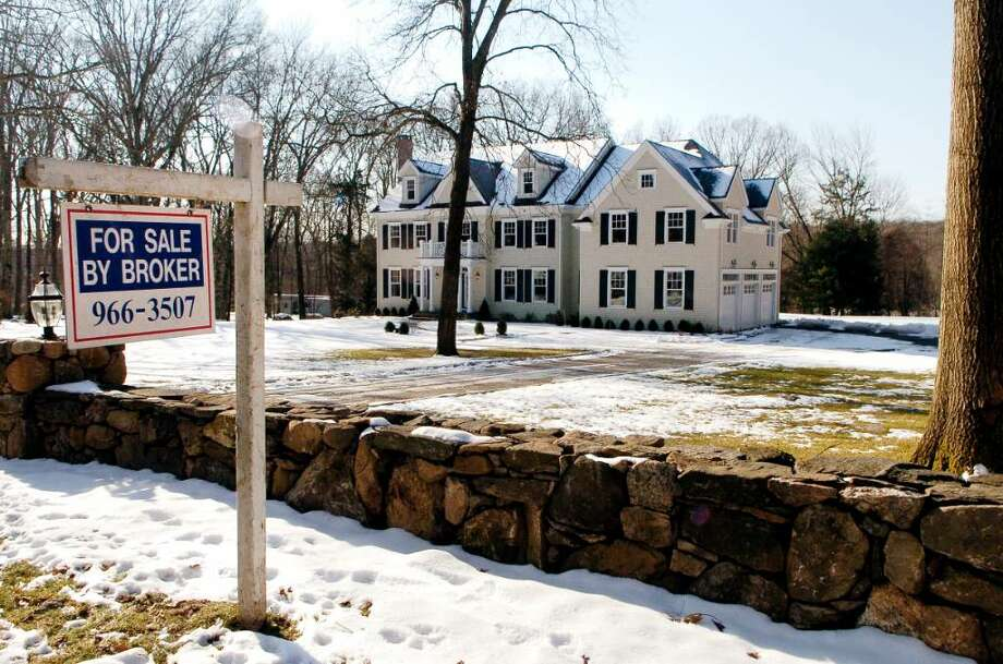 Home for sale on the corner of Ponus Ridge Rd and Reservoir Rd in New Canaan, Conn. on Thursday January 14, 2009. Photo: Dru Nadler / Stamford Advocate