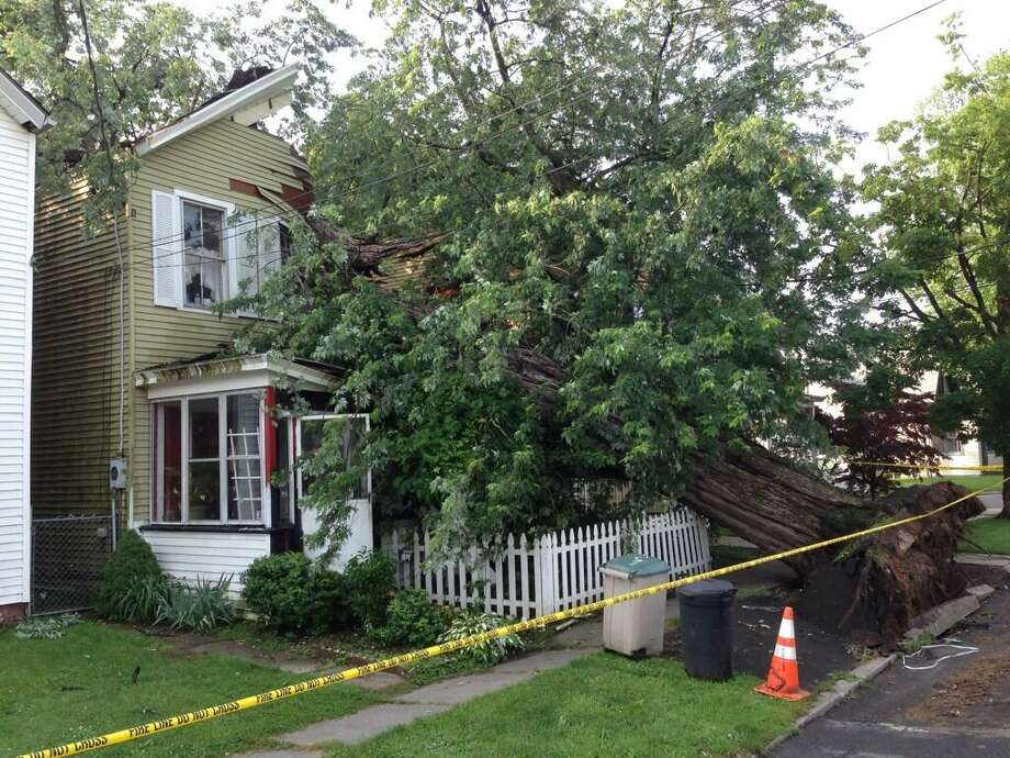 1710 Sixth Street in Rensselaer was heavily damaged by a tree that came down in a thunderstorm Monday night. (Skip Dickstein / Times Union)