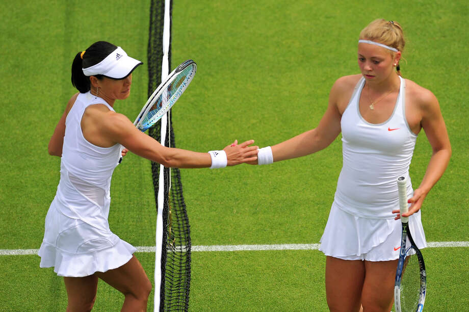 Japan's Kimiko Date-Krumm (L) shakes hands after beating Germany's Carina Witthoeft during their women's first round match on day two of the 2013 Wimbledon Championships tennis tournament at the All England Club in Wimbledon, southwest London, on June 25, 2013. Date-Krumm won 6-0, 6-2. Photo: GLYN KIRK, AFP/Getty Images / 2013 AFP