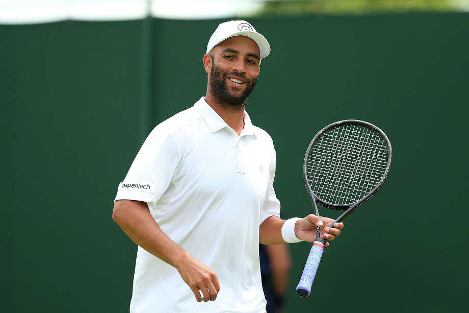 James Blake of the United States of America smiles during his Gentlemen's Singles first round match against Thiemo De Bakker of Netherlands on day two of the Wimbledon Lawn Tennis Championships at the All England Lawn Tennis and Croquet Club on June 25, 2013 in London. Photo: Julian Finney, Getty Images / 2013 Getty Images