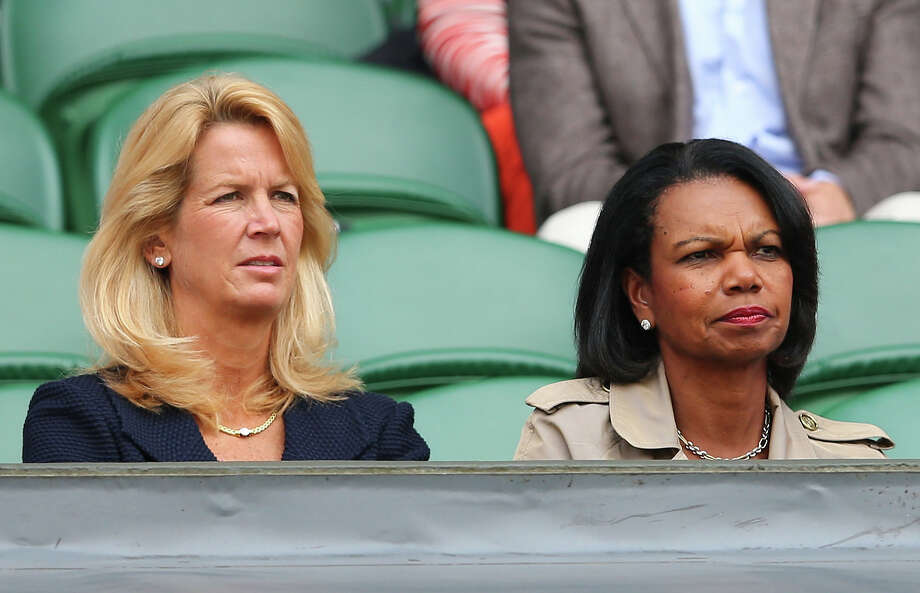Condoleezza Rice (R) and Mariann Byerwalter watch the Ladies' Singles first round match between Serena Williams of the United States of America and Mandy Minella of Luxembourg on day two of the Wimbledon Lawn Tennis Championships at the All England Lawn Tennis and Croquet Club on June 25, 2013 in London, England. Photo: Julian Finney, Getty Images / 2013 Getty Images